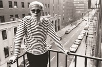 Warhol on fire escape of the Factory, 231 East 47th Street 4