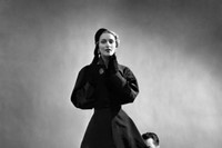 Charles James pinning a suit on model from the Mar 7