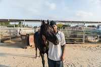 Anthony having a moment with his horse 19