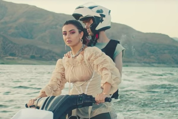 Charli XCX and Troye Sivan ride jet skis in the '2099' video
