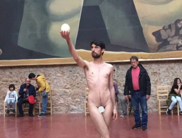 A naked performance artist smashed an egg over Salvador Dalí's tomb
