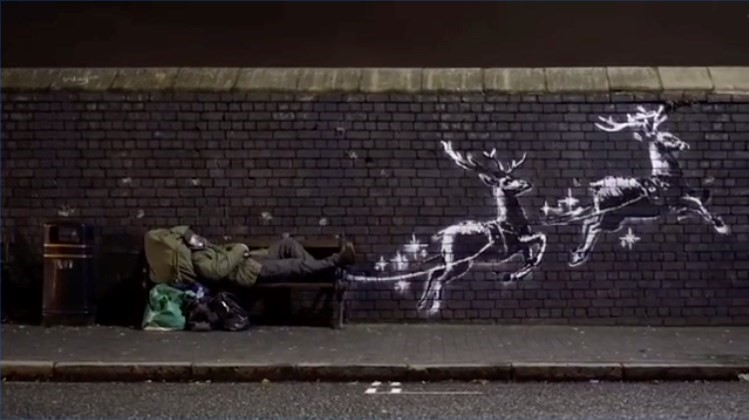 Uk news:Red noses appear on Banksy's Birmingham homeless reindeer mural