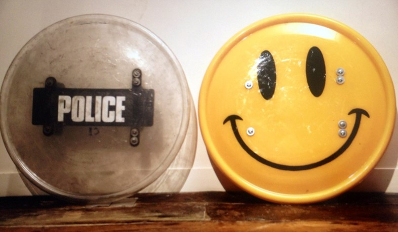 Smiley riot shield before and after