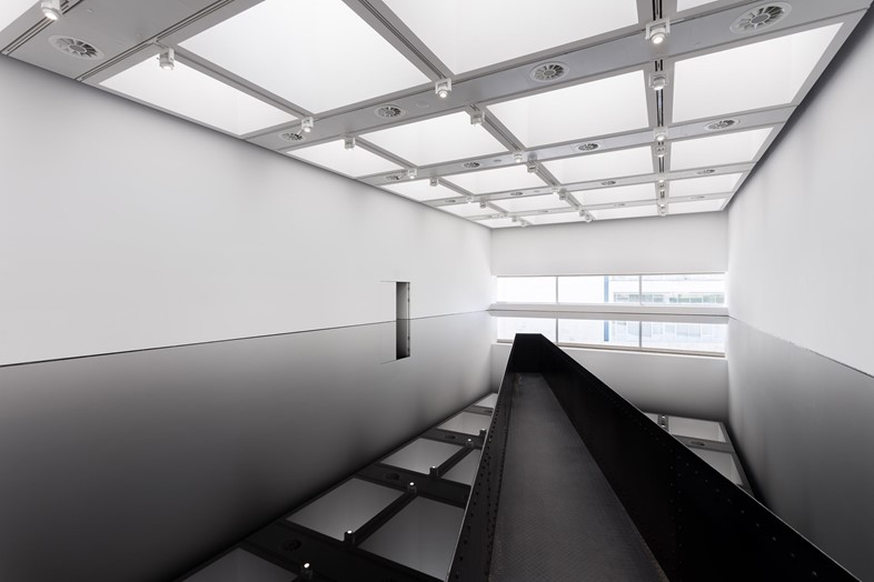 Installation view of Richard Wilson_ 20_50, (1987)
