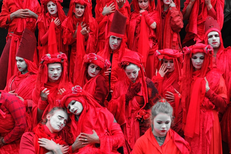 Extinction Rebellion red robed protesters