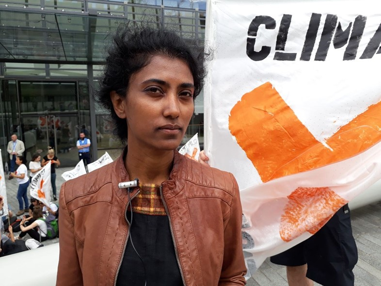 A protester outside EIB for climate action