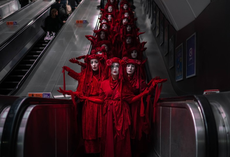 Extinction Rebellion red-robed tube protest