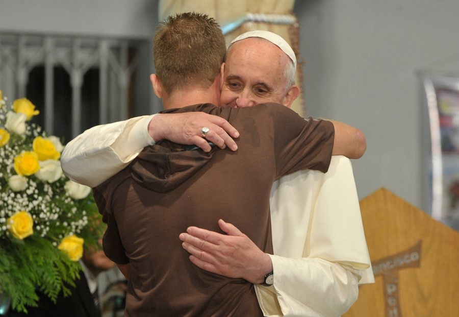 Pope_Francis_hugs_a_man_in_his_visit_to_a_rehab_ho