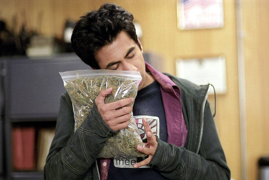 man hugging weed