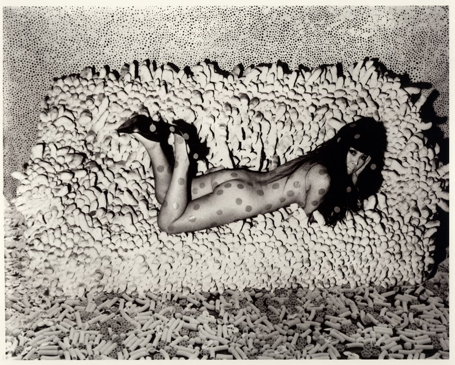 Kusama reclining on Accomulation