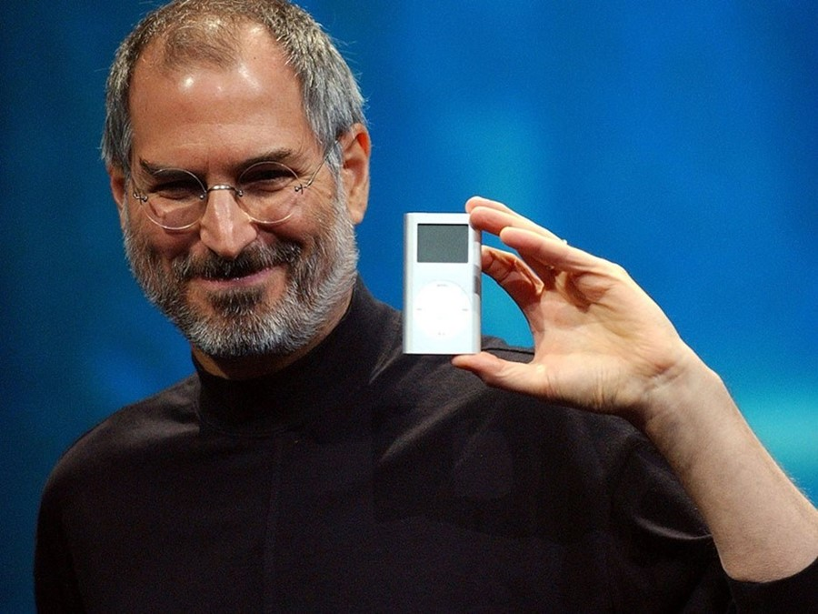 Apple co-founder Steve Jobs with an iPod