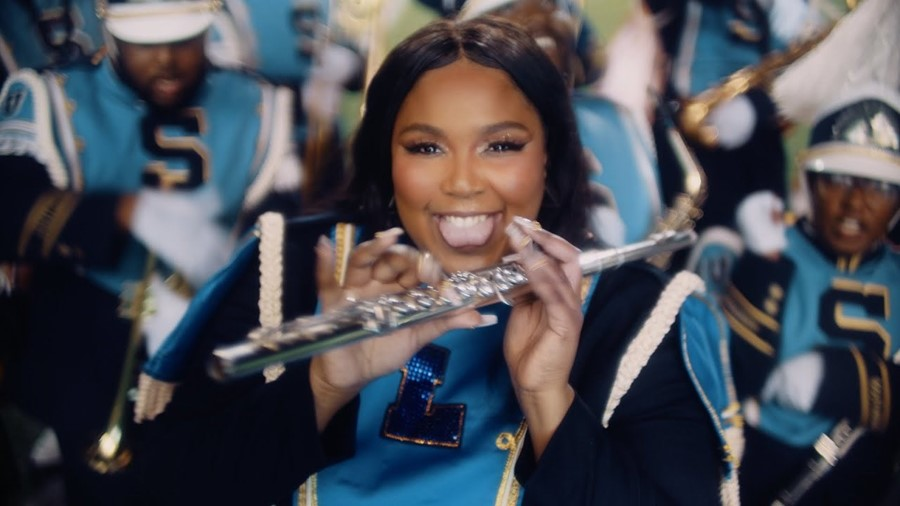 Lizzo leads a marching band in the 'Good as Hell' video