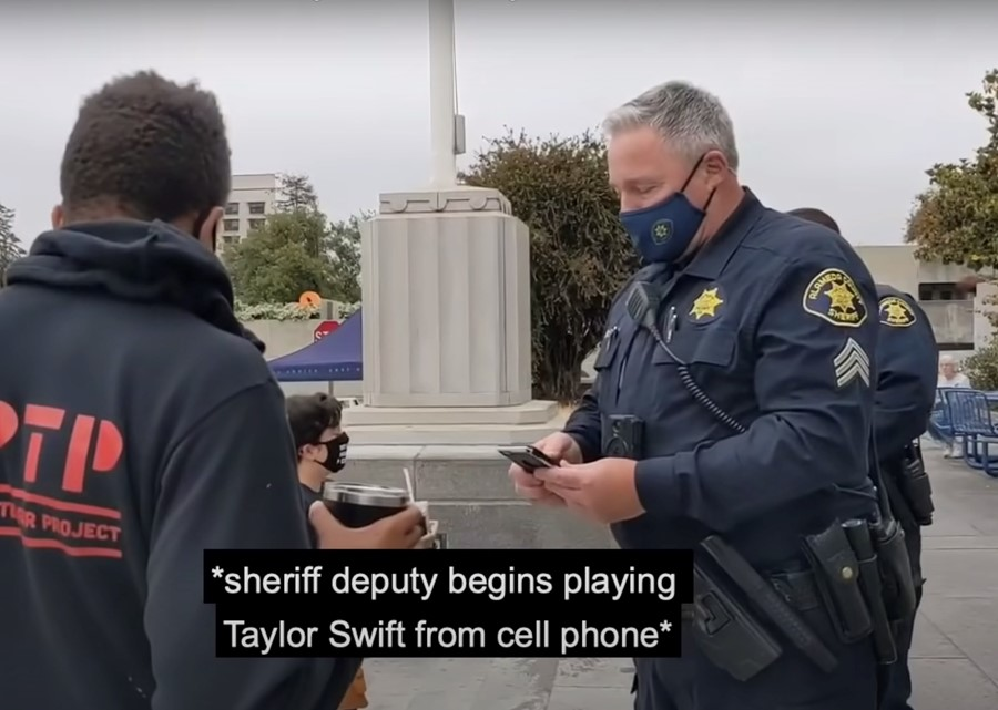 Police play Taylor Swift to block BLM protester's video